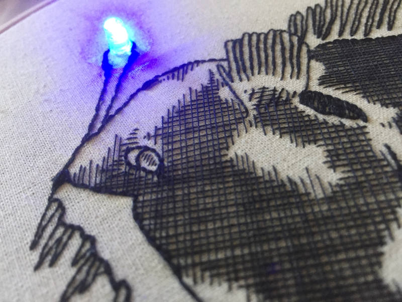 Image of an embroidery pattern with an LED light stiched into it.